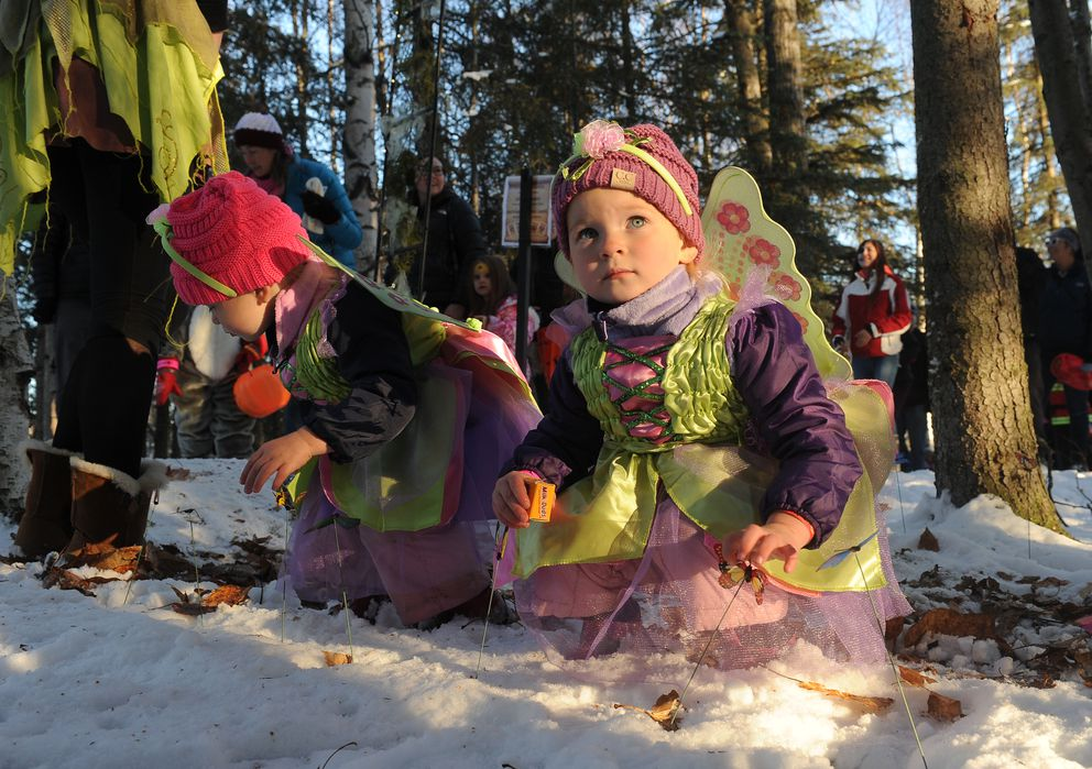 Twins sisters Tegan and Harper Malevich check out the butterflies in the Enchanted Forest at Goose Lake Park in Anchorage, Alaska, on Thursday, October 27, 2016. The pair were dressed up as fairies to take part in the Anchorage Parks and Recreation Halloween trick-or-treat night at the park at Goose Lake. (Bob Hallinen / Alaska Dispatch News)