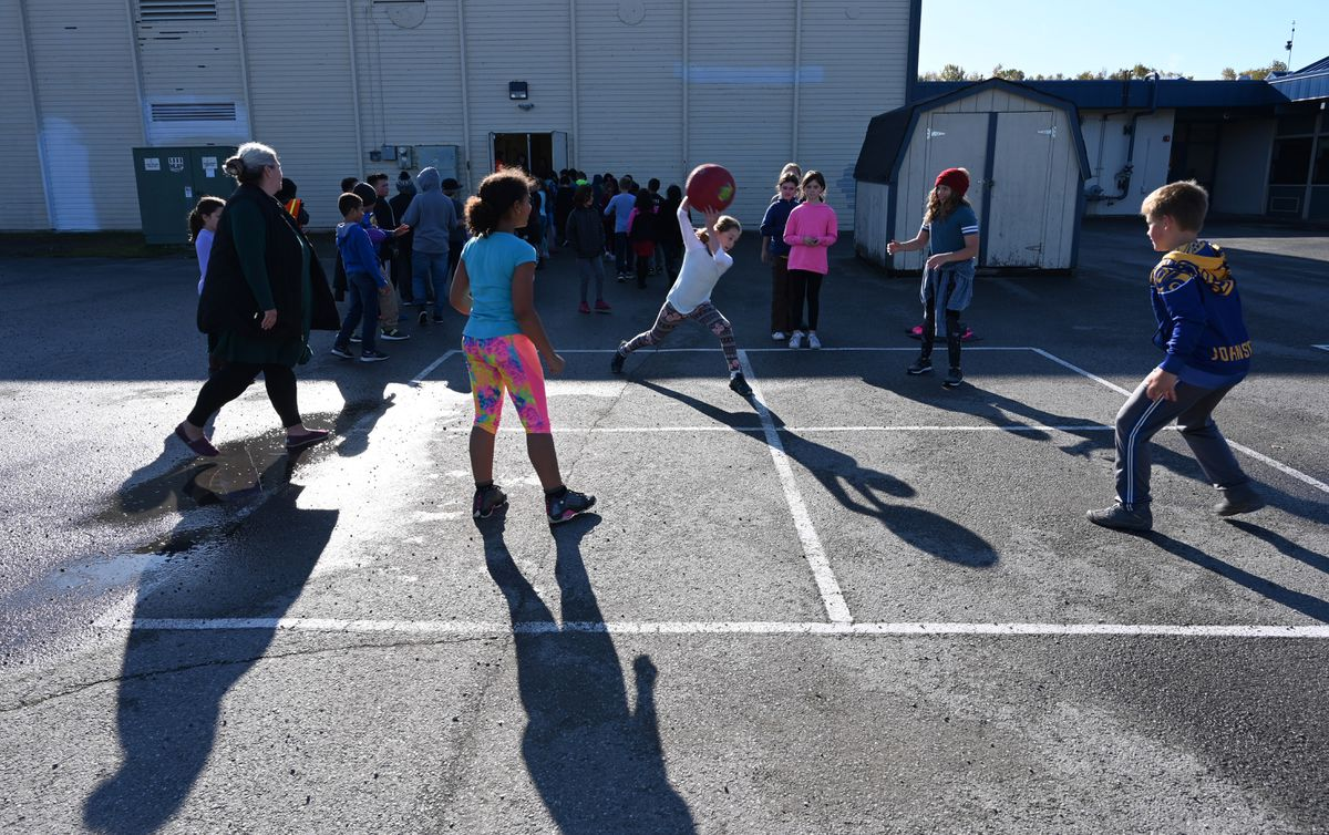 A group of fifth graders play a spirited game of four square during recess at Rogers Park Elementary School, Sept. 26, 2019. Under a new pilot program, they have 30 minutes for recess this year, 10 minutes more than a year ago. (Anne Raup / ADN)