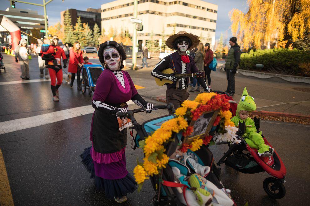 Laura Eichelberger and Austin Fuhrig dress up in a Día de Muertos theme. (Loren Holmes / ADN)