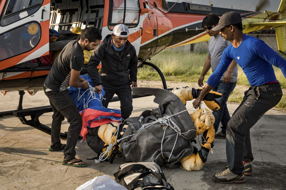 Goutam Ghosh's body arriving by helicopter in Kathmandu, Nepal, May 28, 2017. (Josh Haner/The New York Times)