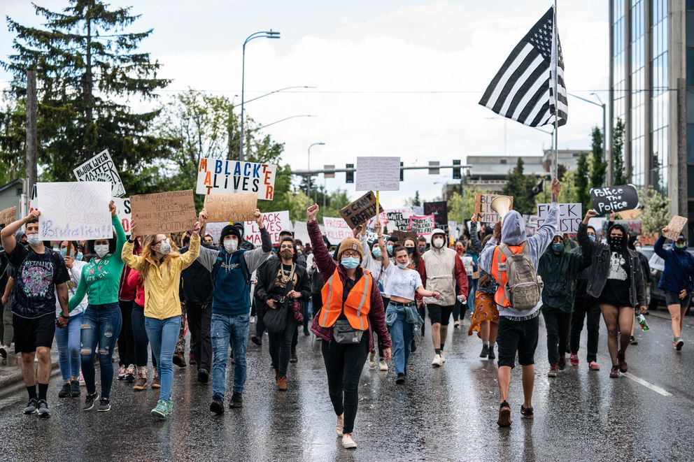 A large crowd marches down I Street. (Loren Holmes / ADN)