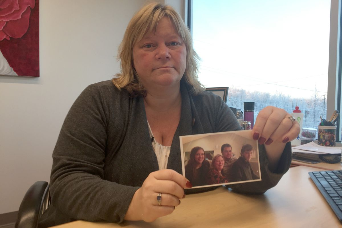 Tucker Sauder died in early December 2016 at the age of 23. His mother, Lisa Sauder, holds a photo of him , at far right, and his siblings. (Devin Kelly / Alaska Dispatch News)
