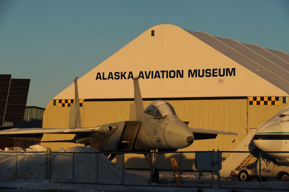 The rising sun lights up an Air Force F-15 fighter jet on display at the Alaska Aviation Heritage Museum on the shore of Lake Hood Float Plane Base in Anchorage on Tuesday, Nov. 28, 2017. (Bob Hallinen / ADN)