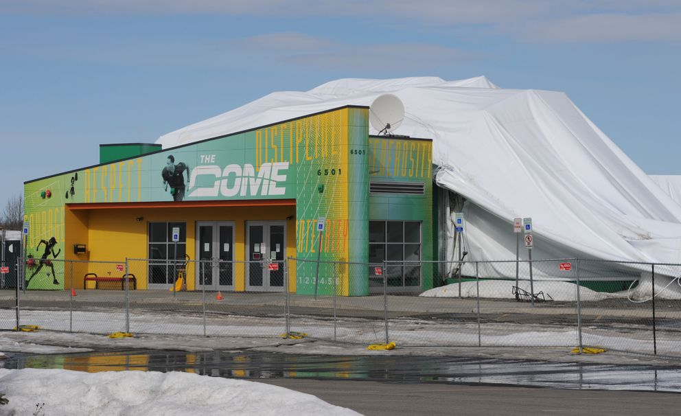 As snow meltedon Monday, April 10, it revealed the collapsed fabric of the inflatableDome sports center. (Bill Roth / Alaska Dispatch News)
