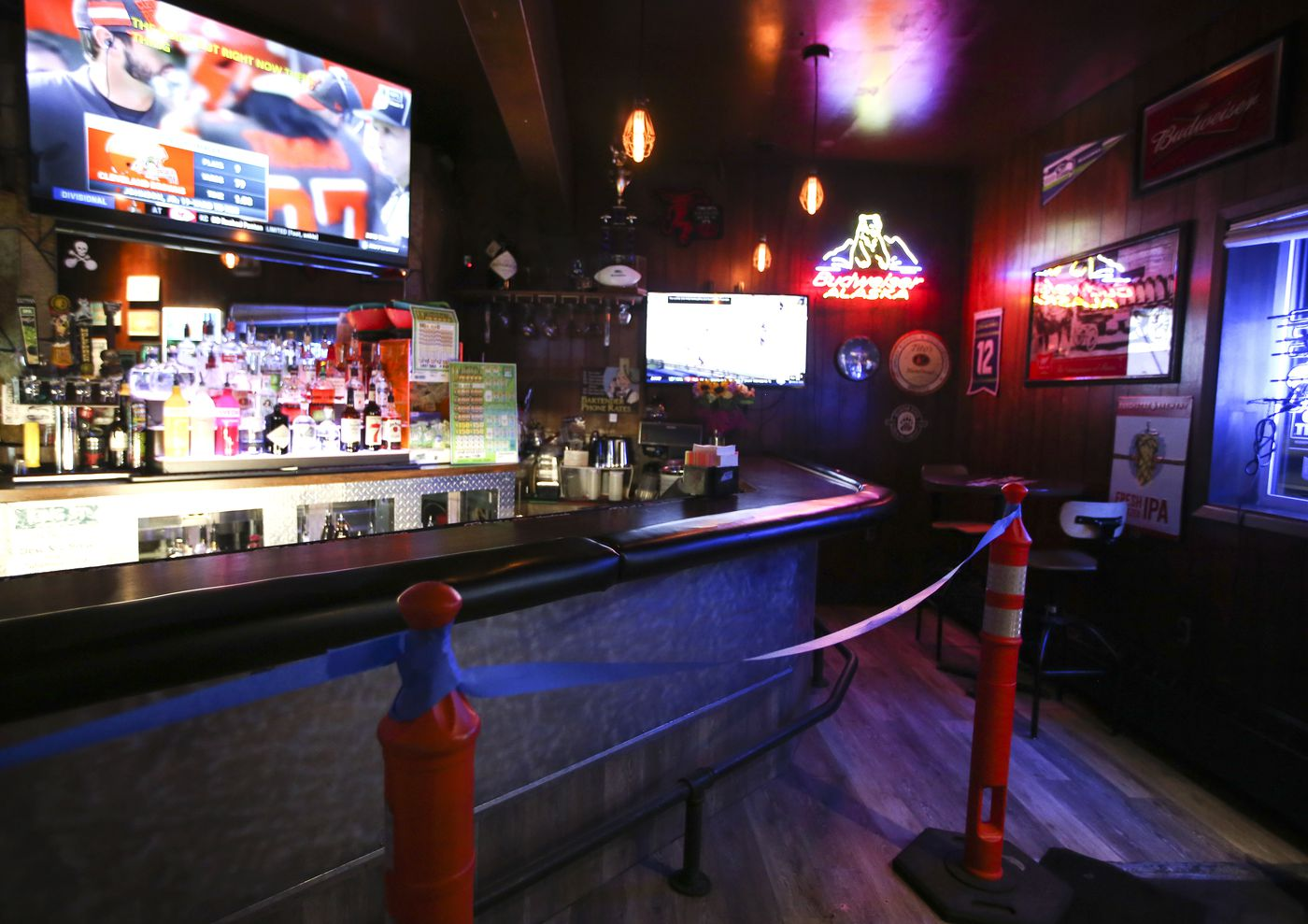Tape blocks off the bar area at Van's Dive Bar in downtown Anchorage on Thursday, Jan. 14, 2021. (Emily Mesner / ADN)