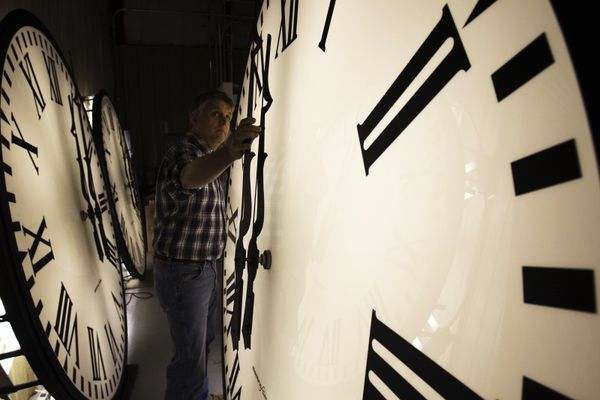 Scott Gow adjusts a tower clock on test at the Electric Time Company in Medfield, Massachusetts March 6, 2009. Daylight saving time begins in the United States at 2 a.m. March 8. REUTERS/Brian Snyder