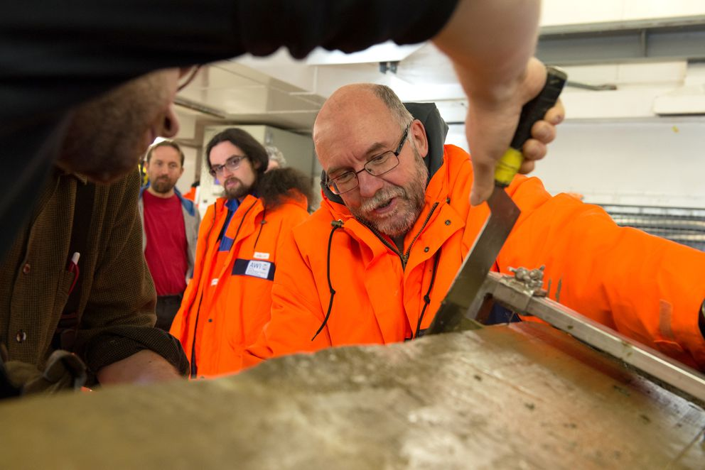 Rüdiger Stein samples a sediment core aboard the Polarstern. (Audun Tholfsen / Alfred Wegener Institute)