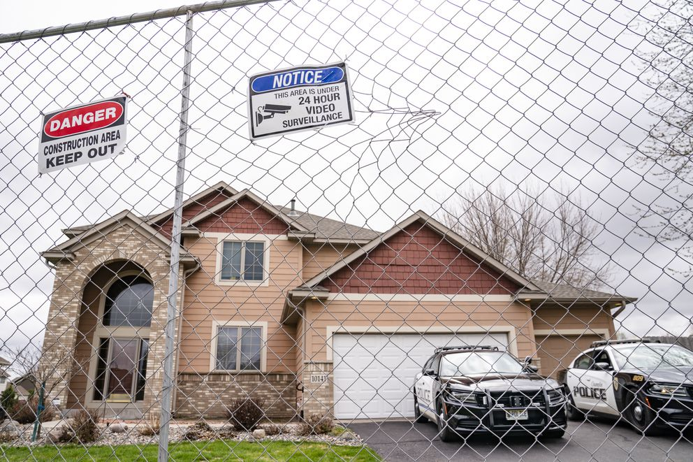 Fencing and concrete barriers surround the home of former Brooklyn Center police officer Kim Potter as local police guard her residence, Wednesday, April 14, 2021, in Champlin, Minn. A prosecutor said Wednesday that he will charge Potter, a white former suburban Minneapolis police officer with second-degree manslaughter for killing 20-year-old Black motorist Daunte Wright in a shooting that ignited days of unrest and clashes between protesters and police. (AP Photo/John Minchillo)