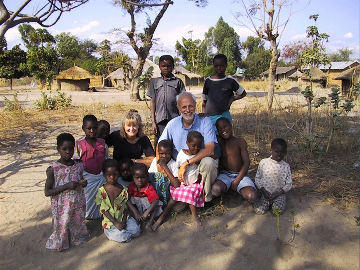 Ruth and Tom Nighswander visit with children served by the Malawi Children's Village support program for orphans and vulnerable children in Chipoka, Malawi, in 2011. (Courtesy Tom and Ruth Nighswander)