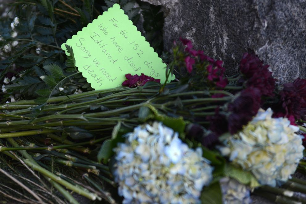 A note mourning the loss of the dogs in the Iditarod on the sled dog sculpture on Fourth Avenue. (Anne Raup / Alaska Dispatch News)