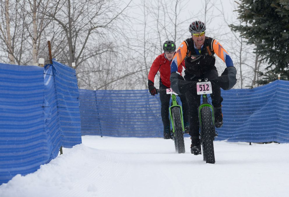Rob Whitney leads down the hill coming off of the Tudor bridge during the 50K fat bike race in the Tour of Anchorage. (Anne Raup / ADN)