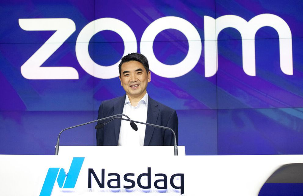 In this April 18, 2019, photo, Zoom CEO Eric Yuan attends the opening bell at Nasdaq as his company holds its IPO in New York. (AP Photo/Mark Lennihan, File)