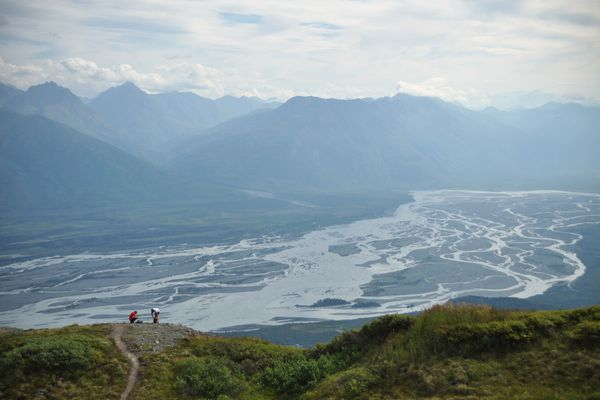 Hikers rest along the Pioneer Ridge Trail, which overlooks the Knik River, on Aug. 8, 2015. (Vicky Ho / ADN archive)