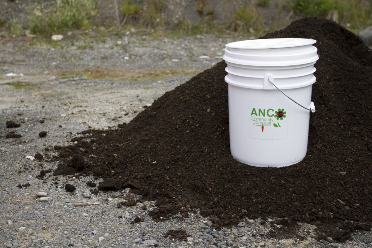 Anchorage Solid Waste Services' 5-gallon bucket sits on top of a pile of Susitna Organics' composted soil during a press conference held by SWS to announce the start of a community composting pilot program at the Anchorage Regional Landfill on Monday, July 11, 2016. To participate in the pilot program, residents must sign up and use an official bucket to transport waste to the landfill. (Sarah Bell / Alaska Dispatch News)