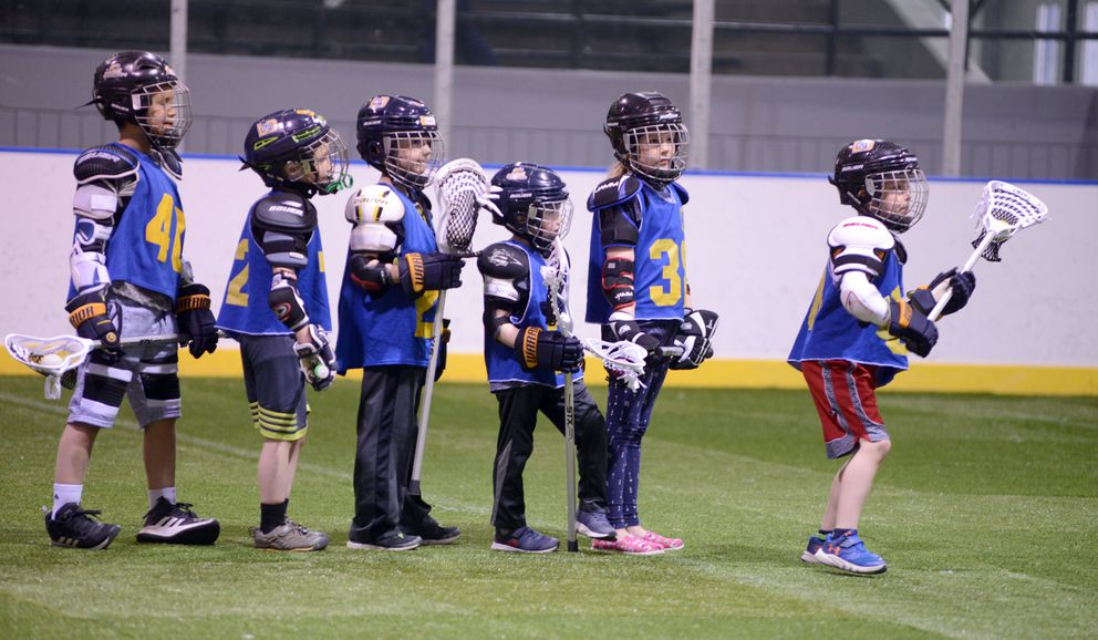 8U lacrosse players line up for drills on Wednesday, May 30.  (Anne Raup / ADN)