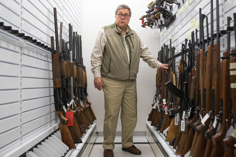 U.S. Attorney General William Barr looks at reference guns in the Alaska State Crime Lab. (Loren Holmes / ADN)