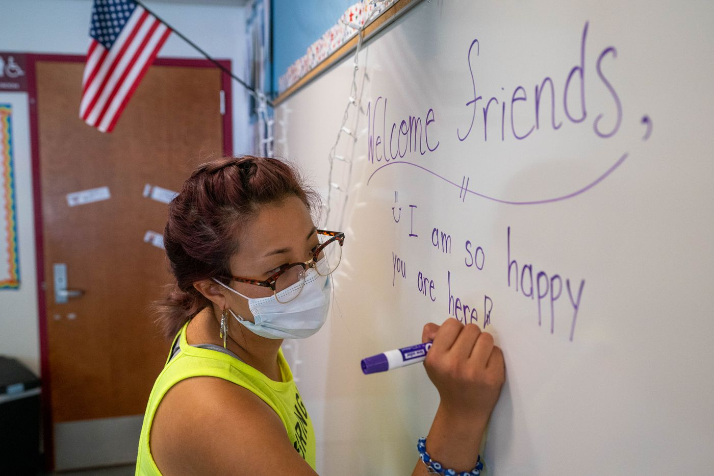 AUGUST 13. First-grade teacher Katrina Kim writes a welcome message on the whiteboard in her classroom at Nunaka Valley Elementary School. Kim said she is prepping for both remote and in-person teaching, because she wants to be ready if the school district changes plans. (Loren Holmes / ADN)