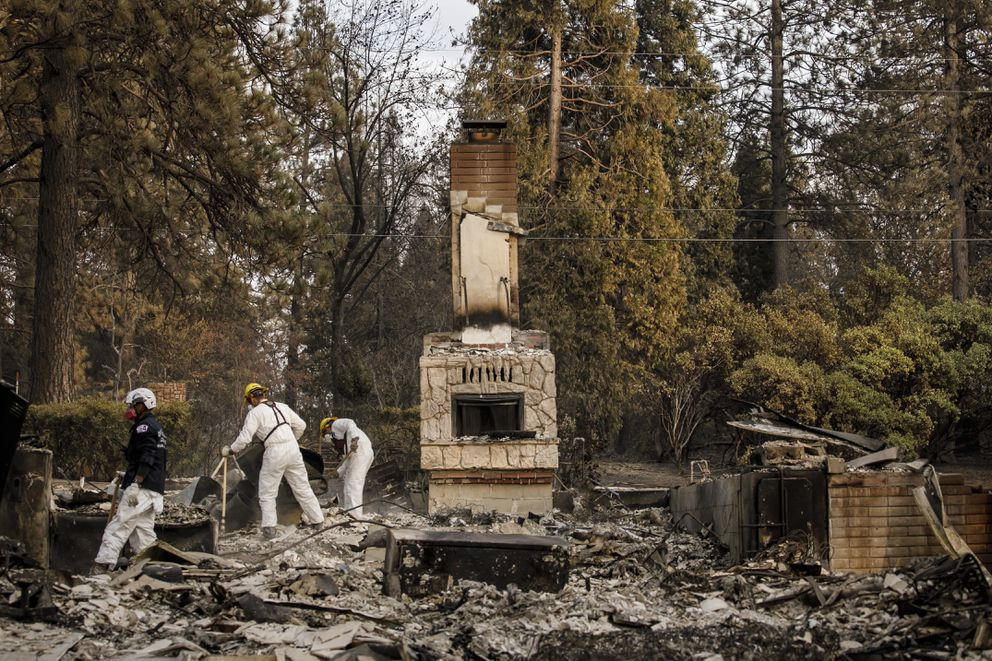 A search and rescue team comb through debris for human remains after the Camp Fire destroyed most of Paradise, Calif., on Nov. 20, 2018. (Marcus Yam/Los Angeles Times/TNS)