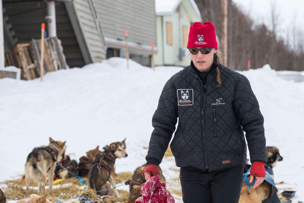 Aliy Zirkle tends to her dogs Friday, March 9, 2018 in Shageluk. (Loren Holmes / ADN)