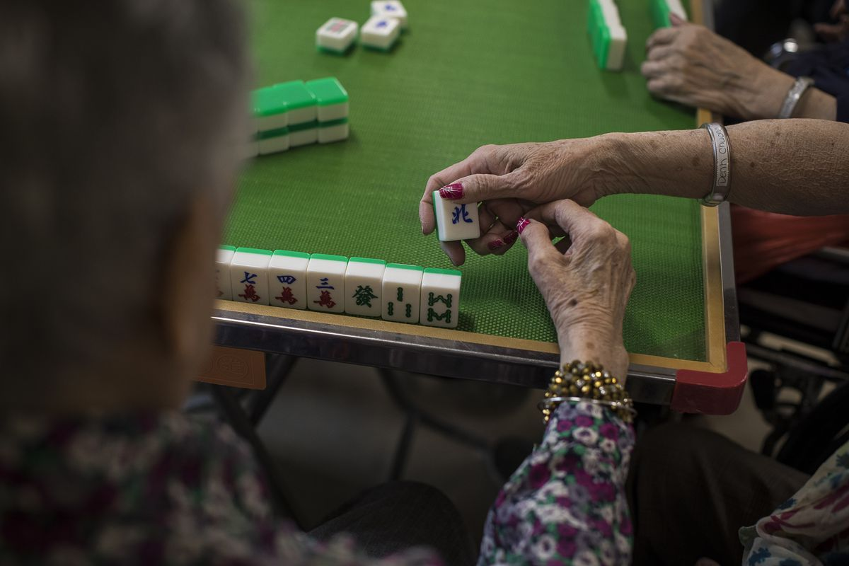 A game of mah-jongg at a nursing home in Voorhees, N.J., Nov. 11, 2017. Many nursing home residents are unaware of their rights — legal advocates say that many of them do not even realize they have the right to challenge their discharge. (Edu Bayer/The New York Times)