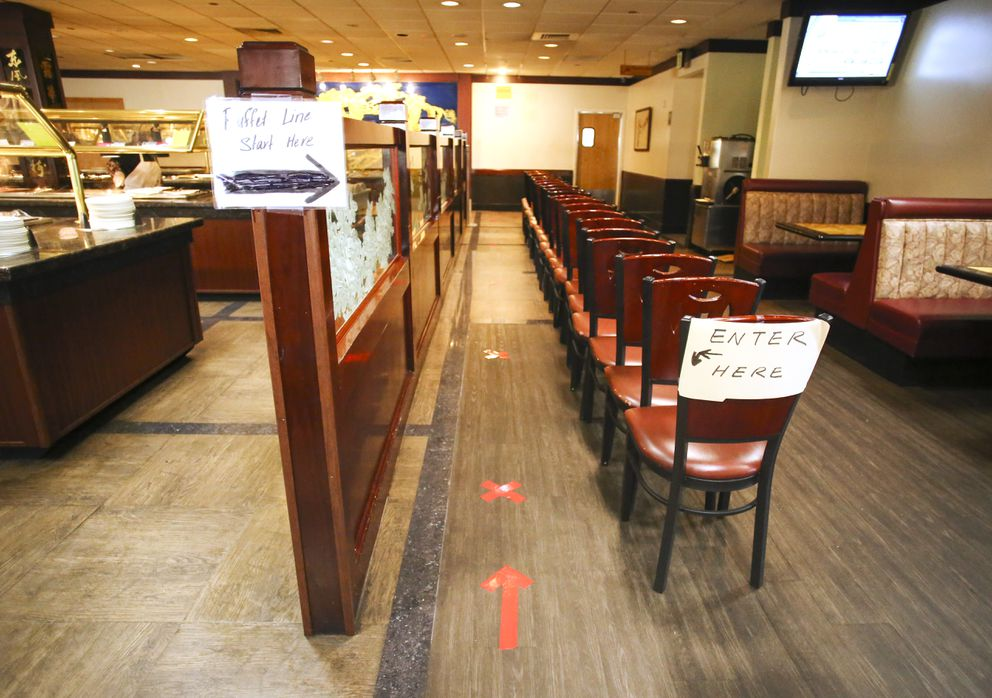 Signs and tape direct customers to the buffet at China Lights Oriental Cuisine in Anchorage on July 20, 2020. (Emily Mesner / ADN)