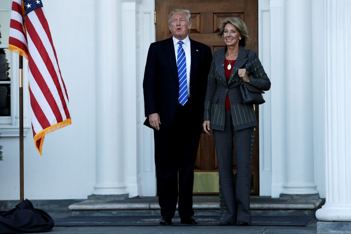 U.S. President-elect Donald Trump stands with Betsy DeVos after their meeting at the main clubhouse at Trump National Golf Club in Bedminster, New Jersey, November 19, 2016. REUTERS/Mike Segar