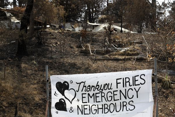 A sign is displayed beside a burned out house near Mogo, Australia, Thursday, Jan. 9, 2020, thanking