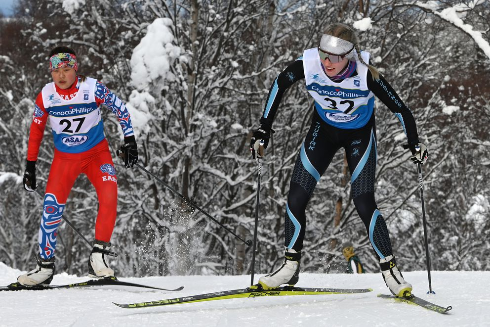 Chugiak senior Adrianna Proffitt, right, leads East junior Mamie Johnson up a hill on her way to third place. (Bill Roth / ADN)