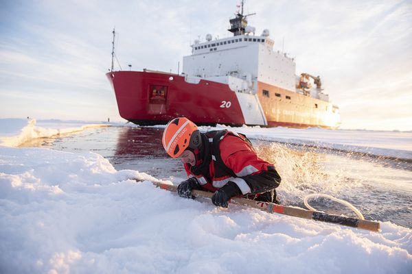 U.S. Coast Guard Petty Officer 2nd Class Richard Wells pulls himself out from the Arctic Ocean during ice rescue training on Oct. 3, 2018, about 715 miles north of Barrow, Alaska. Wells is a crew member aboard the Coast Guard Cutter Healy. MUST CREDIT: U.S. Coast Guard photo by Senior Chief Petty Officer NyxoLyno Cangemi