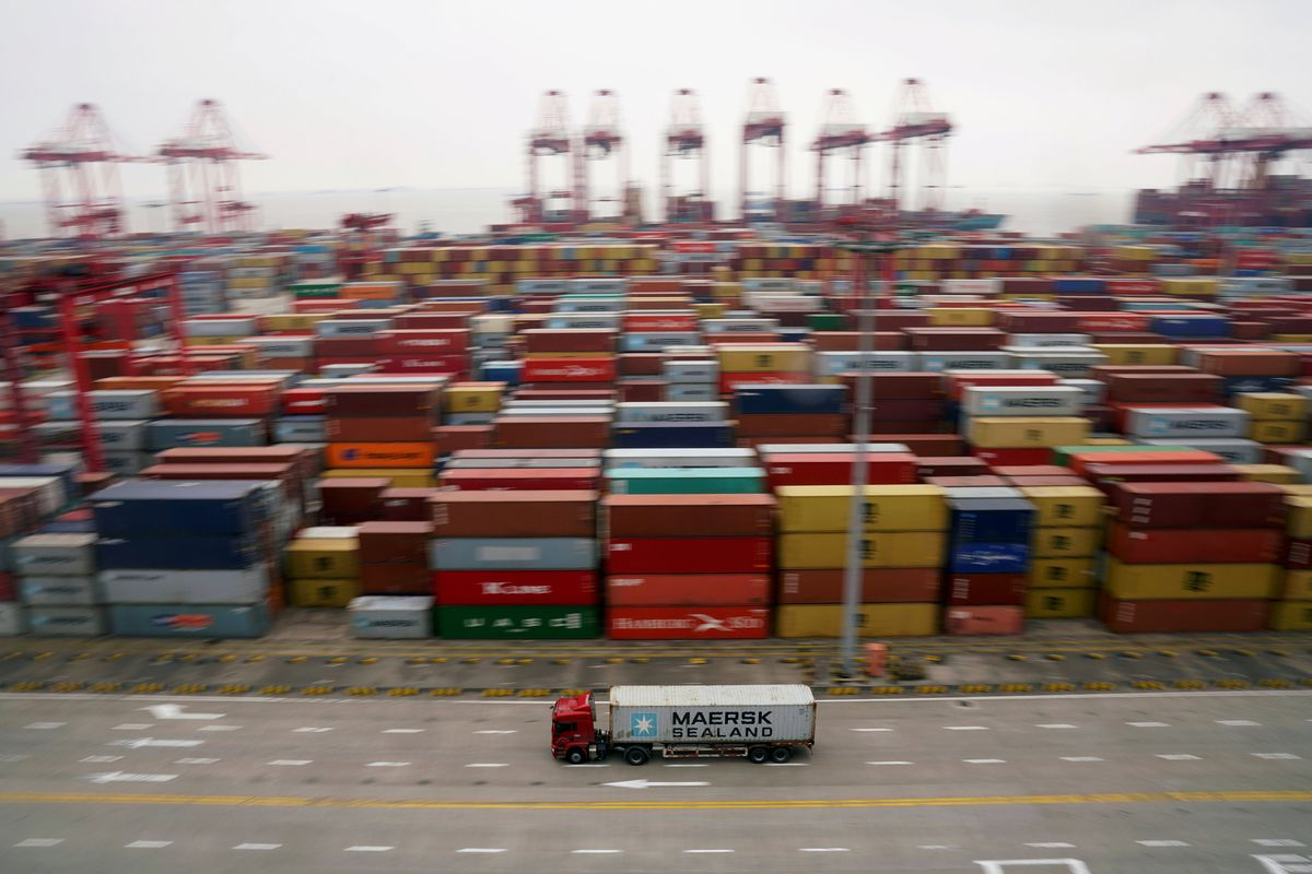 A container truck leaves the Yangshan Deep Water Port in Shanghai in April. REUTERS/Aly Song/File