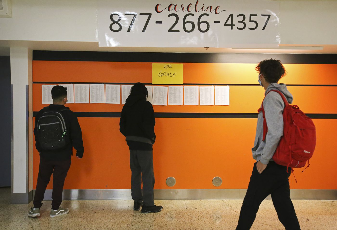 Tenth grade students at West Anchorage High School look for their names to find their first classroom as they return to in-person learning on Tuesday. (Emily Mesner / ADN)