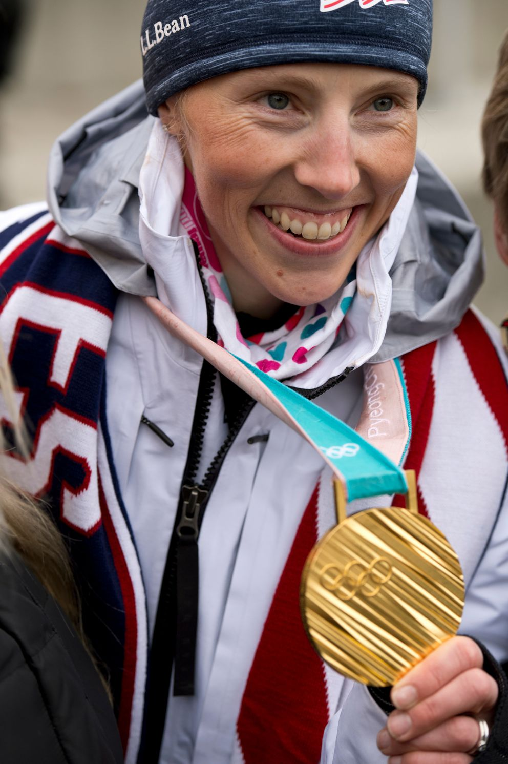 Kikkan Randall poses for photographs with her Olympic gold medal during a celebration in Town Square on April 4. (Marc Lester / ADN)