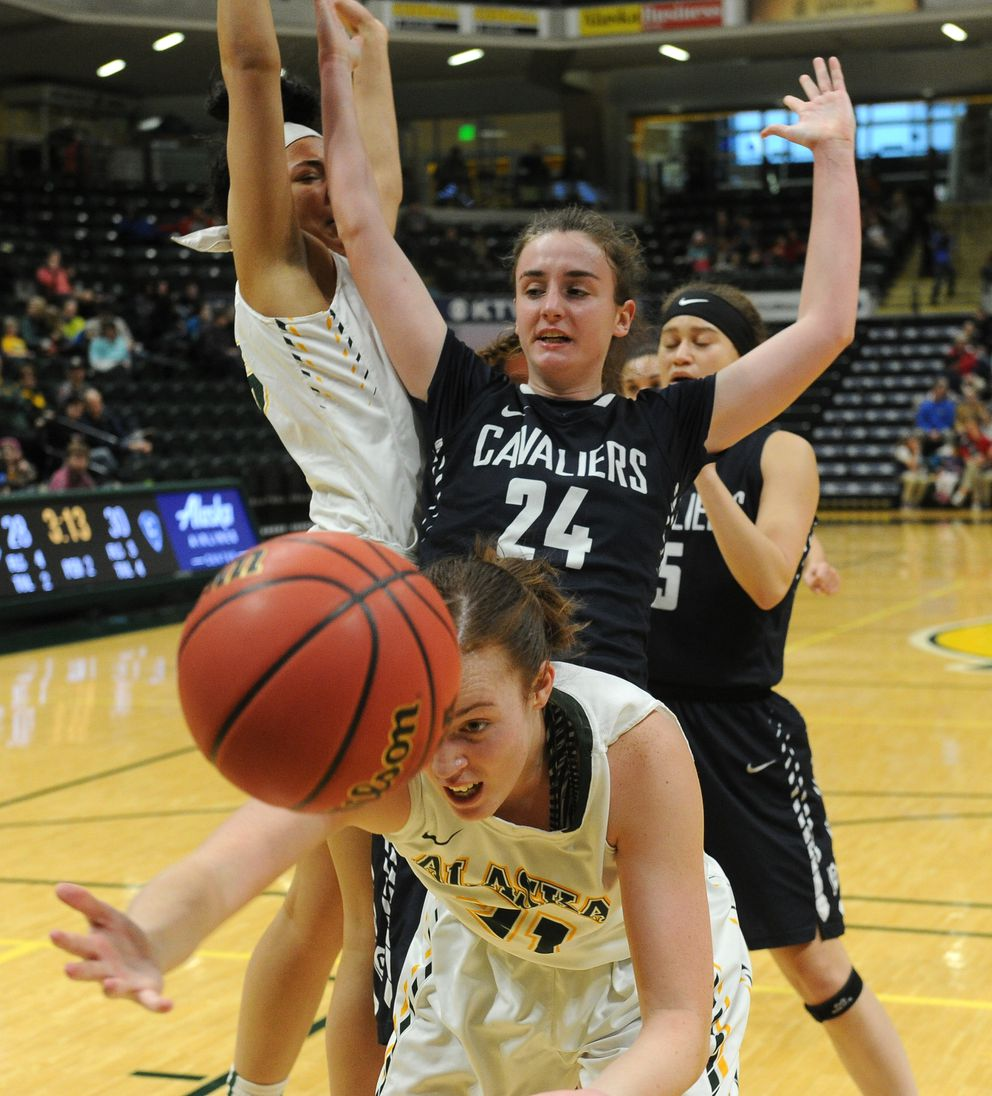 Kaitlyn Hurley, in foreground, tries to keep the ball from going out of bounds as teammate Tennae Voliva, left, , and Concordia's Iraide Juez (24) battle behind her. (Bob Hallinen / ADN)