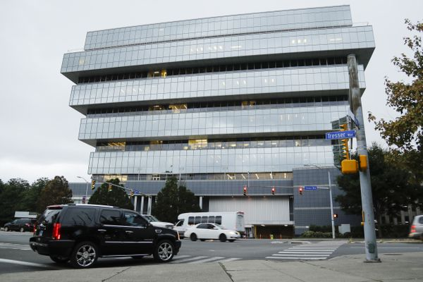 FILE - In this Sept. 12, 2019, file photo, cars pass Purdue Pharma headquarters in Stamford, Conn. The company, which makes OxyContin and other drugs, filed court papers in New York on Sunday, Sept. 15 seeking Chapter 11 bankruptcy protection. (AP Photo/Frank Franklin II, File)