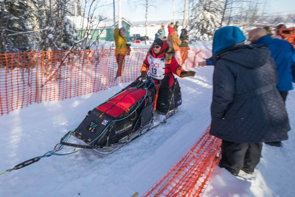 Defending Iditarod champion Mitch Seavey leaves Willow Lake during the start of the Iditarod Trail Sled Dog Race on Sunday. (Loren Holmes / ADN)