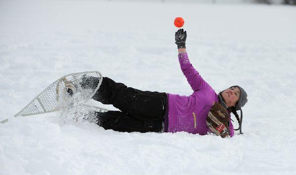Fielder Stephanie Dush throws the ball in during the Fur Rondy snowshoe softball tournament at Kosinski Fields in 2017. (Bob Hallinen / ADN)