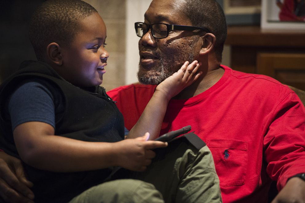 Dominick Evans, 4, plays with his adoptive father Barry Evans in their Anchorage home. (Marc Lester / ADN)