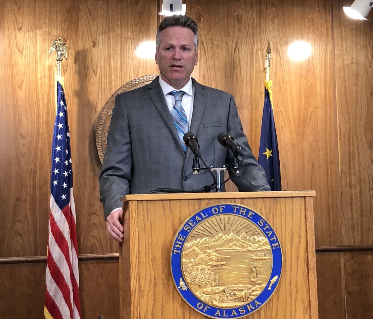 Alaska Gov. Mike Dunleavy reveals his budget vetoes during a press conference Friday, June 28, 2019 at the Alaska State Capitol in Juneau. (James Brooks / ADN)