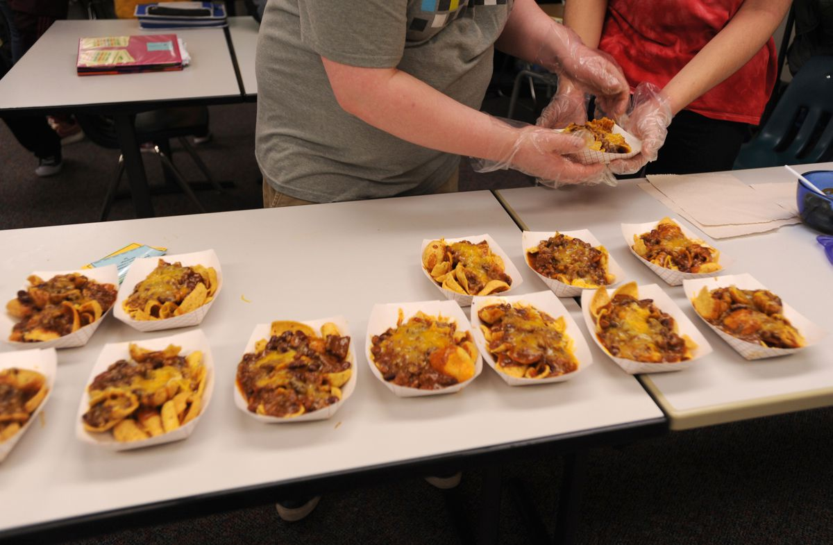 Frito pies are arranged for sale Friday, Oct. 13, 2017, at Service High School. (Anne Raup / Alaska Dispatch News)