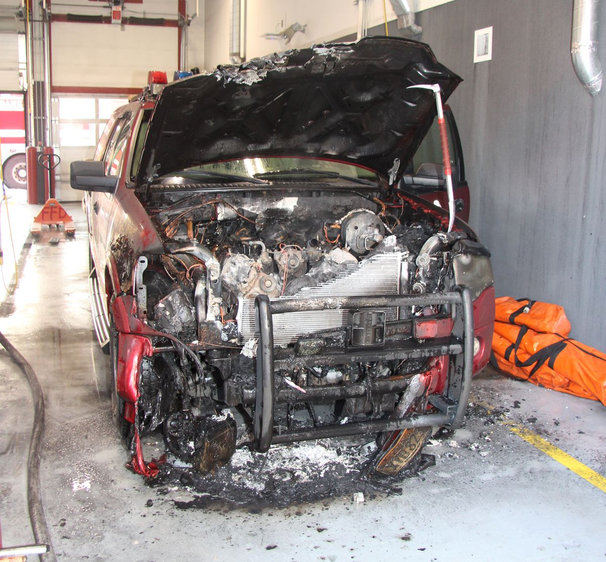 A Ford Expedition used as a Battalion Chief vehicle caught fire in a garage bay at Fairbanks Fire Department's downtown headquarters on Saturday, March 10, 2018. (Fairbanks Fire Department)