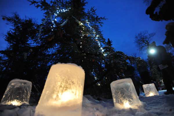 Ice luminaria surround a tree decorated by the West High ski team at the inaugural Solstice Tour of Trees hosted by the Nordic Skiing Association of Anchorage was wildly popular as people skied and walked the Mize Loop at Kincaid Park on Sunday, Dec. 18, 2016, during the community celebration of snow, Winter Solstice, and holiday trees. (Bill Roth / Alaska Dispatch News)