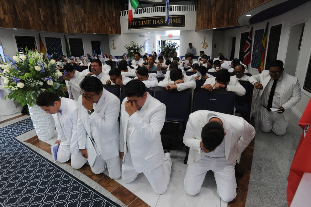 Men cry tears of joy during a prayer of reconciliation asking God for forgiveness and liberty for their souls during the first ever service inside the La Luz del Mundo temple. (Bill Roth / ADN)