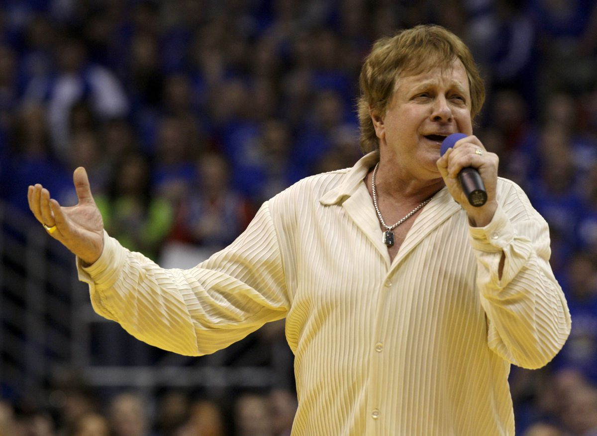 Eddie Money sings the national anthem Jan. 25, 2010, before an NCAA college basketball game in Lawrence, Kan. (AP Photo/Charlie Riedel, File)