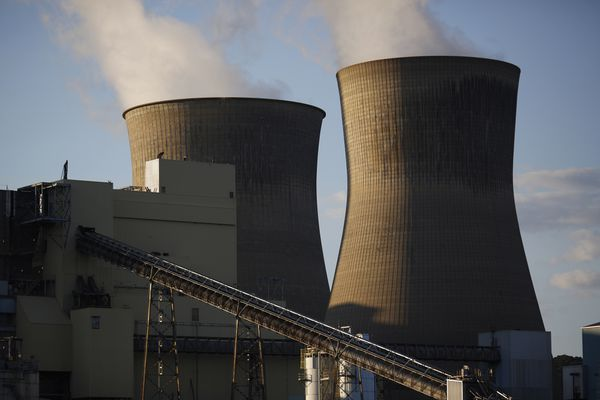 Steam rises from cooling towers at the American Electric Power Co. coal-fired power plant in Winfield, W.Va., on July 18. (Bloomberg photo by Luke Sharrett)