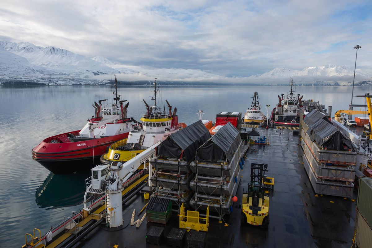 Tugboats are docked alongside a barge at the SERVS facility in Valdez on Feb. 15, 2016. The tugs escort oil tankers through Prince William Sound, and the barge supports nearshore oil spill recovery operations. (Loren Holmes / ADN)