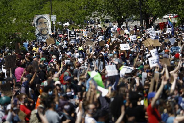 FILE - In this May 30, 2020, file photo, people gather for a rally in Minneapolis, following the death of George Floyd. (AP Photo/Julio Cortez)