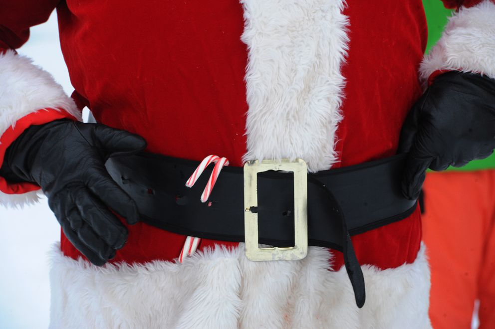 Santa has a couple candy canes tucked away in his belt during a surprise visit at the Delaney Park Strip. (Bill Roth / ADN)