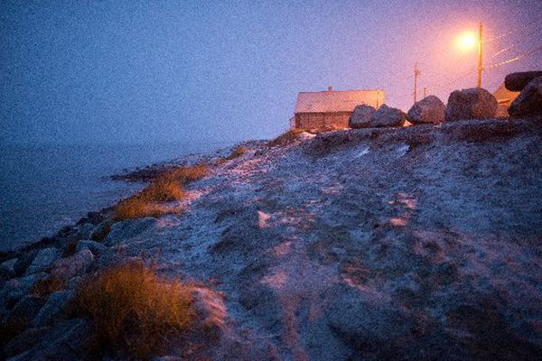 A trail leads up a bluff in Shishmaref, a northwest Alaska village that has gained international attention for erosion attributed to climate change. (MARC LESTER/ADN archive 2013)