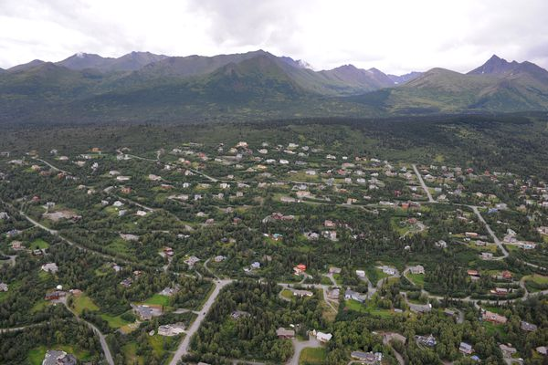 Aerial view of the Anchorage hillside above Upper O'Malley Road, lower left, and the Chugach Mountains on July 27, 2016. Homeowners concerned about protecting their homes in the event of a wildfire can learn more through the Anchorage Fire Department's Firewise Home Assessment Program. (Bill Roth / Alaska Dispatch News)