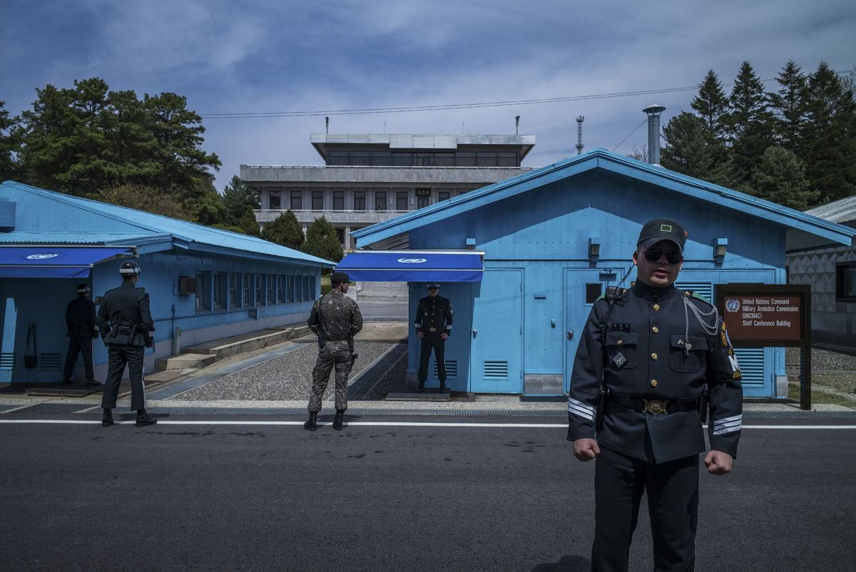 Soldiers stand guard outside meeting rooms that straddle the border between North and South Korea in Panmunjom along the Demilitarized Zone, April 19, 2017. (Lam Yik Fei / The New York Times)
